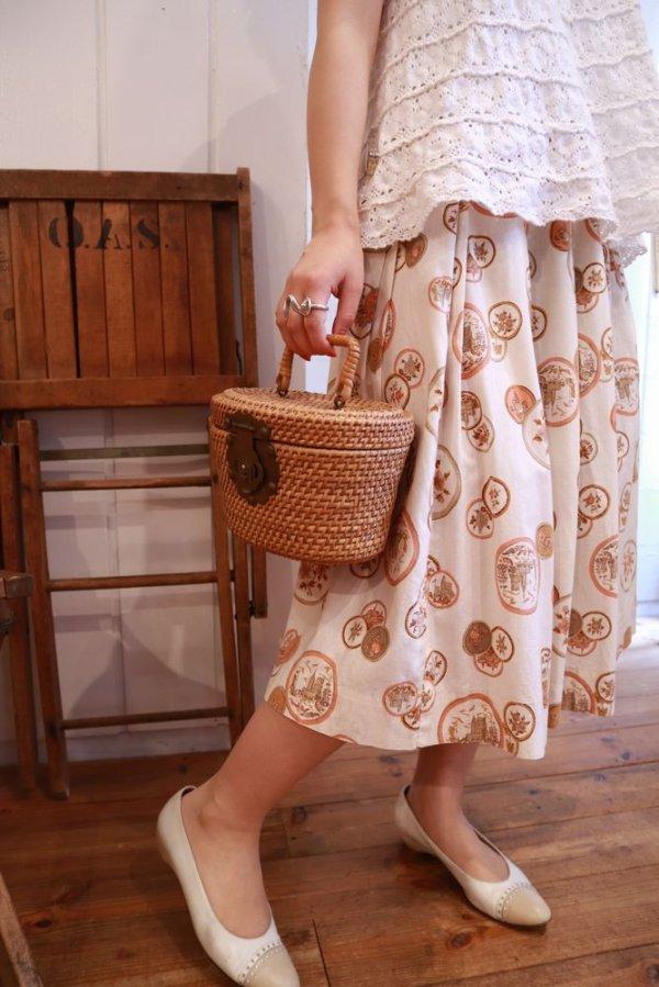 画像1: 50〜60年代ホワイト×ペールオレンジ×ブラウン〇&花柄フレアスカート
